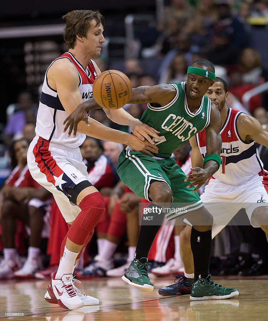 Washington Wizards small forward Jan Vesely (24) and Boston Celtics shooting guard Jason Terry (4) go after a loose ball during the first half of their game played at the Verizon Center in Washington, D.C., Saturday, November 3, 2012.