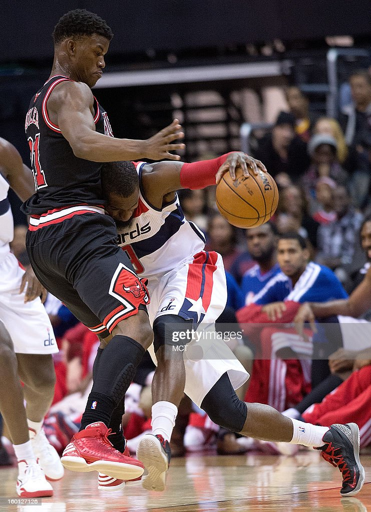 Washington Wizards small forward Martell Webster (9) crashes into Chicago Bulls small forward Jimmy Butler (21) during the first half of their game played at the Verizon Center in Washington, D.C., Saturday, January 26, 2013.