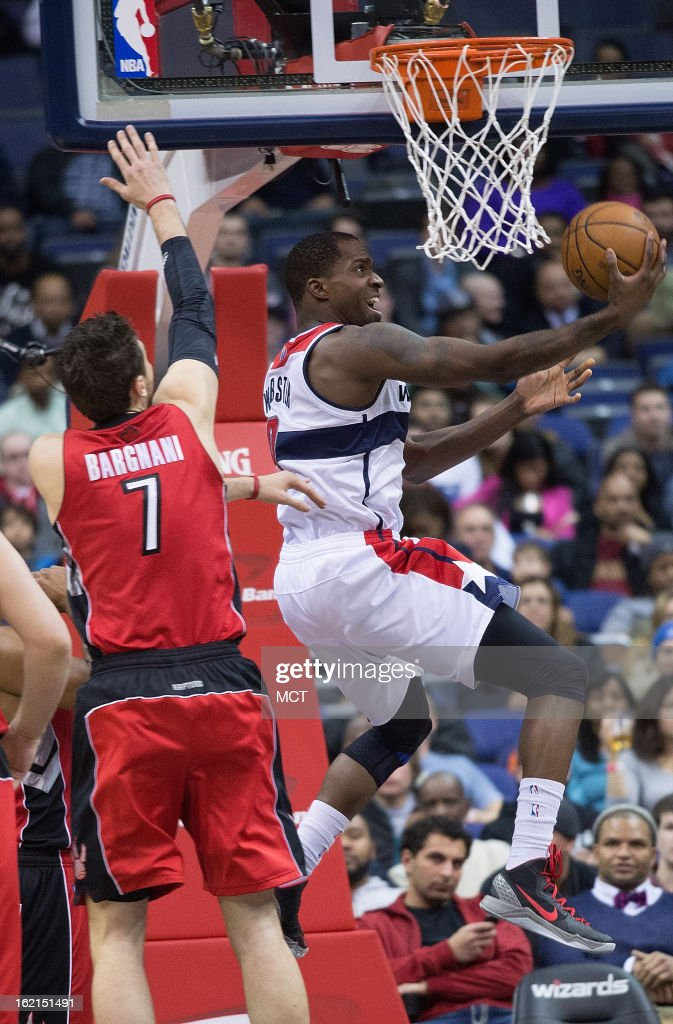 Washington Wizards small forward Martell Webster (9) does a revers layup past Toronto Raptors center Andrea Bargnani (7) during the first half of their game played at the Verizon Center in Washington, D.C., Tuesday, February 19, 2013.