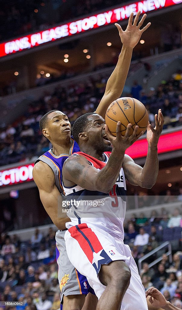 Washington Wizards small forward Martell Webster (9) drives to the basket on Phoenix Suns small forward Wesley Johnson (2) during the second half of their game played at the Verizon Center in Washington, D.C., Saturday, March 16, 2013. Washiington defeated Phoenix 127-105.