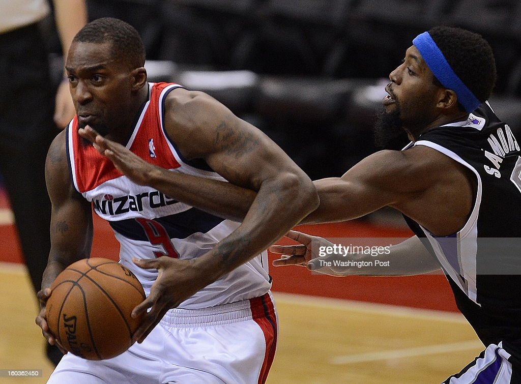 Washington Wizards small forward Martell Webster (9) gets fouled by Sacramento Kings small forward John Salmons (5) during first half of the game at the Verizon Center on Monday, January 28, 2013.
