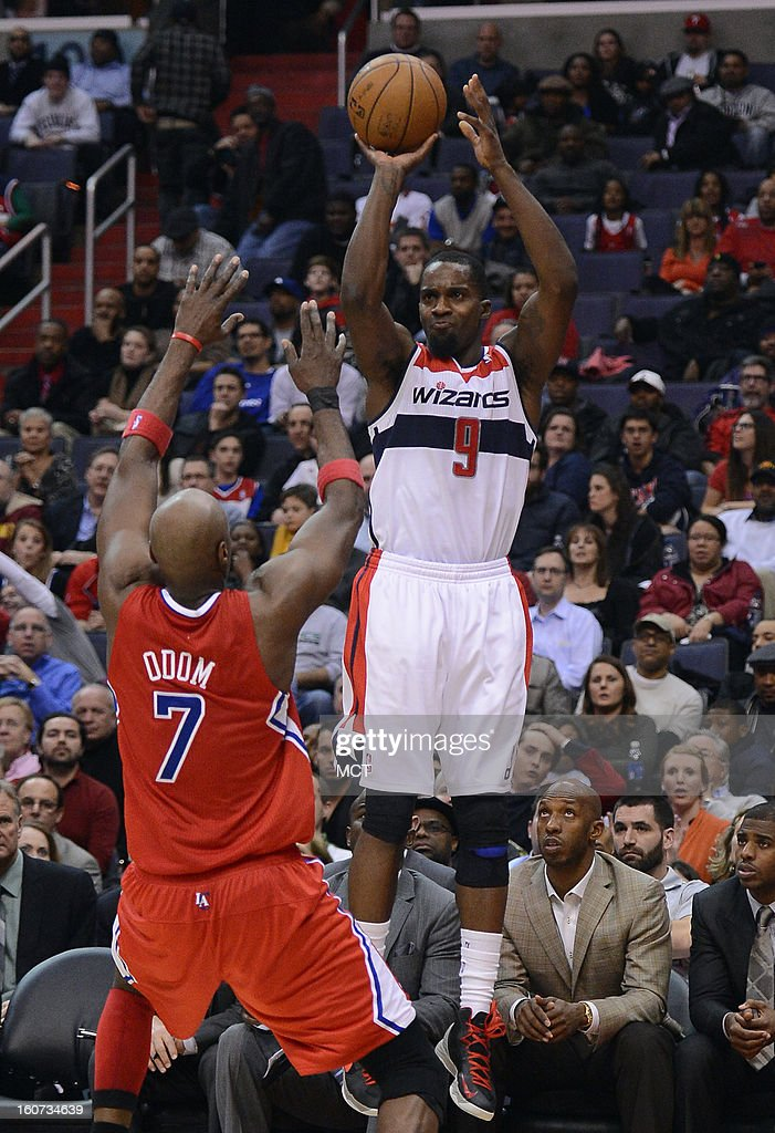 Washington Wizards small forward Martell Webster (9) hits a three-point shot over Los Angeles Clippers power forward Lamar Odom (7) in the fourth quarter at the Verizon Center in Washington, D.C., Monday, February 4, 2013. The Wizards defeated the Clippers, 98-90.
