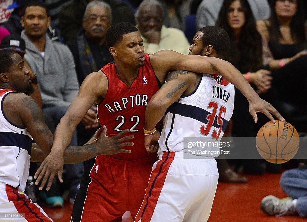 Washington Wizards small forward Martell Webster (9), left, and Washington Wizards power forward Trevor Booker (35), right, try to stop Toronto Raptors small forward Rudy Gay (22) during the second half of the game against the Toronto Raptors at the Verizon Center on Tuesday, February 19, 2013. The Toronto Raptors defeated the Washington Wizards 96-88.
