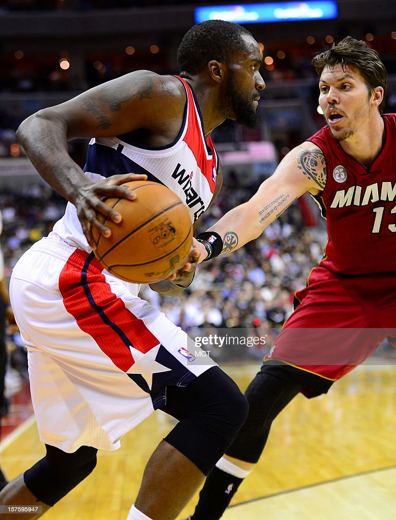 Washington Wizards small forward Martell Webster (9) looks to drive against Miami Heat small forward Mike Miller (13) in the fourth quarter at the Verizon Center in Washington, D.C., Tuesday, December 4, 2012. The Wizards defeated the Miami, 105-101.