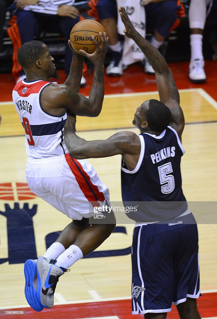Washington Wizards small forward Martell Webster (9) puts up a shot against Oklahoma City Thunder center Kendrick Perkins (5) in the third quarter the Verizon Center in Washington, D.C., Monday, January 7, 2013.