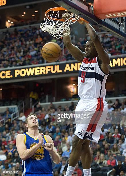 Washington Wizards small forward Martell Webster slam dunks while Golden State Warriors power forward David Lee looks on during the second half of...