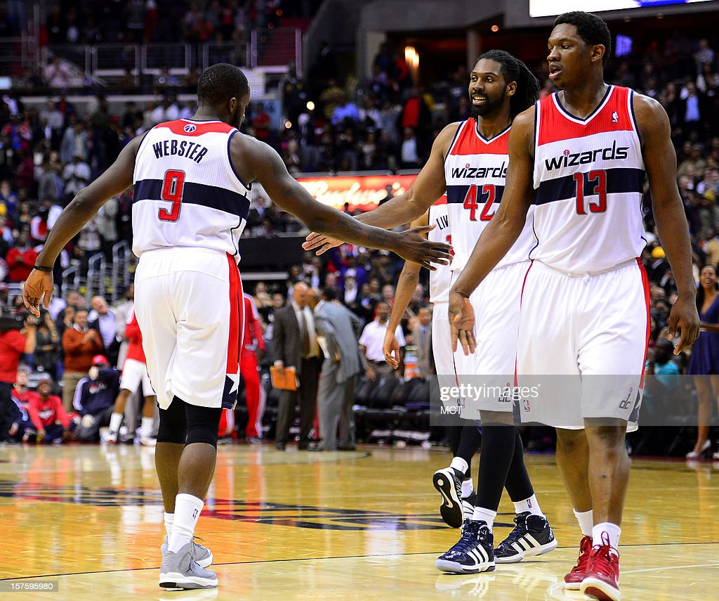 Washington Wizards small forward Martell Webster (9), Wizards center Nene (42) and Wizards power forward Kevin Seraphin (13) begin to celebrate near the end of a 105-101 victory over the Miami Heat at the Verizon Center in Washington, D.C., Tuesday, December 4, 2012.
