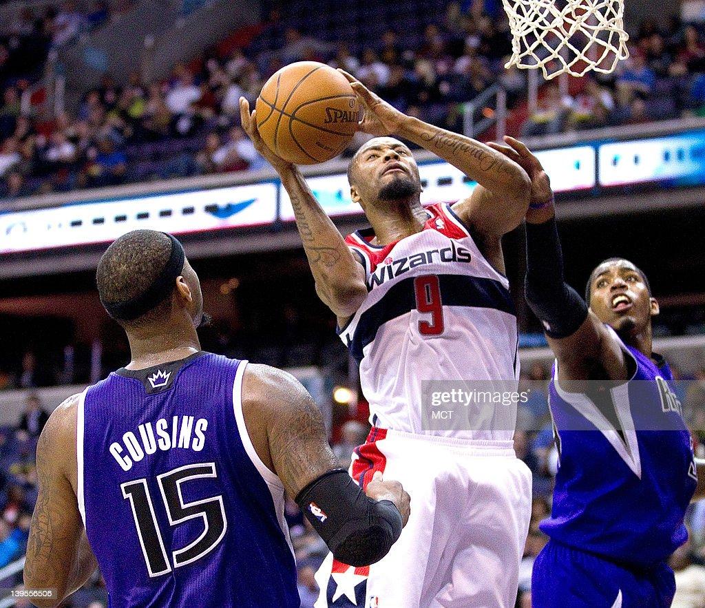 Washington Wizards small forward Rashard Lewis shoots over Sacramento Kings power forward DeMarcus Cousins left and center Jason Thompson during the...