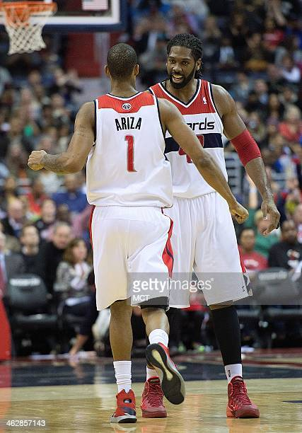 Washington Wizards small forward Trevor Ariza and power forward Nene Hilario celebrate a large lead during the second half of their game against the...