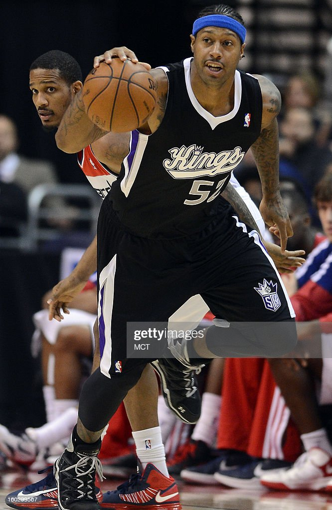 Washington Wizards small forward Trevor Ariza back watches as Sacramento Kings power forward James Johnson heads up court with a Wizards turnover in...