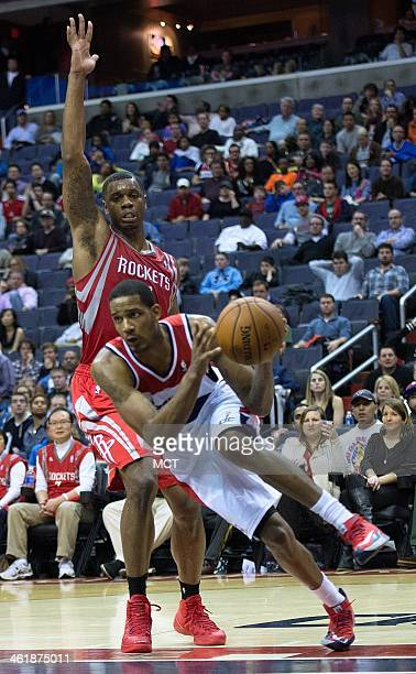 Washington Wizards small forward Trevor Ariza looks to pass the ball after driving by Houston Rockets power forward Terrence Jones during the second...