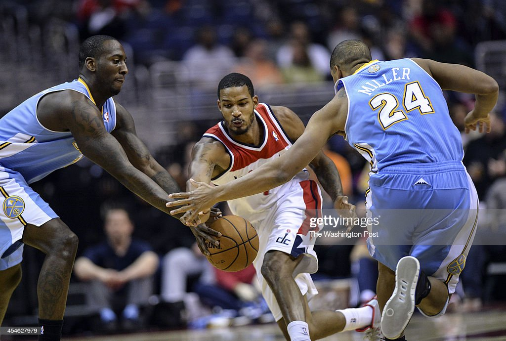 Washington Wizards small forward Trevor Ariza (1) steals the ball as Denver Nuggets power forward J.J. Hickson (7) tries to pass it off to Denver Nuggets point guard Andre Miller (24) during the game between the Washington Wizards and the Denver Nuggets at the Verizon Center on Monday, December 9, 2013.