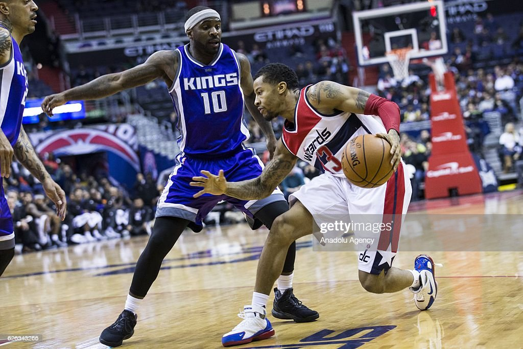 Washington Wizards' Trey Burke (33) in action against Sacramento Kings' Ty Lawson (10) during the NBA basketball game between Washington Wizards and Sacramento Kings at the Verizon Center in Washington, USA on November 28, 2016.