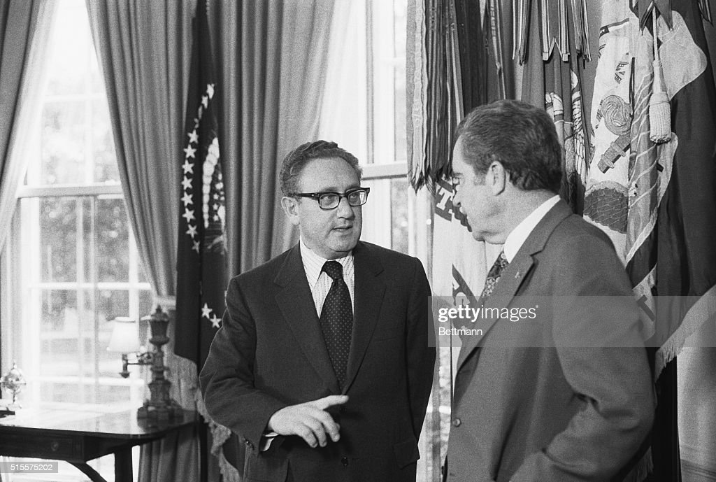 Washington-President Nixon and Henry A. Kissinger pose for cameras in the oval office after Secy. of State Kissinger won the Nobel Peace Prize for Paris negotiations on the Vietnam War. 10/16/73.