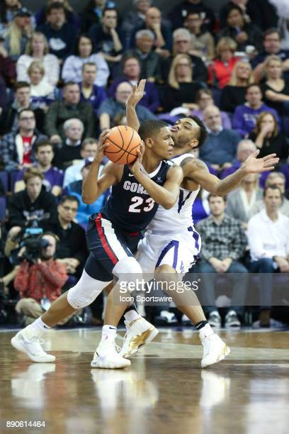 Washington's Carlos Johnson tries to block out Gonzaga's Zach Norvell Jr from driving to the basket Gonzaga won 9770 over Washington on December 10...