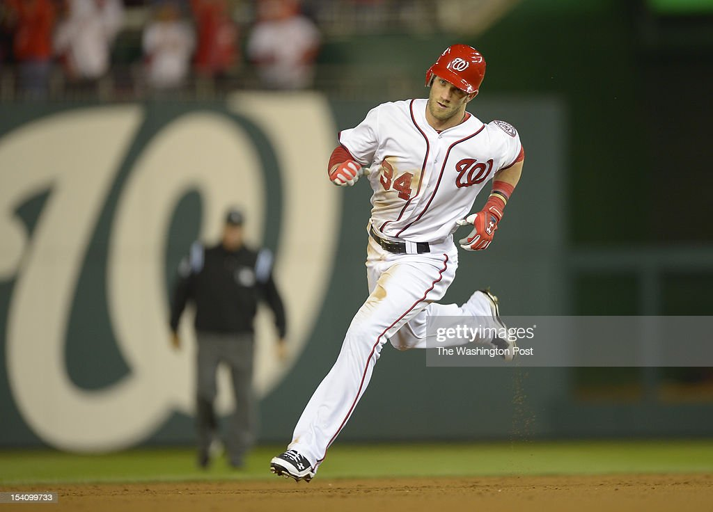 Washington's center fielder Bryce Harper (34) rounds the bases after hitting a solo home run in the third inning as the Washington Nationals play the St. Louis Cardinals in game 5 of the National League Divisional Playoff at Nationals Park in Washington DC, October 12, 2012