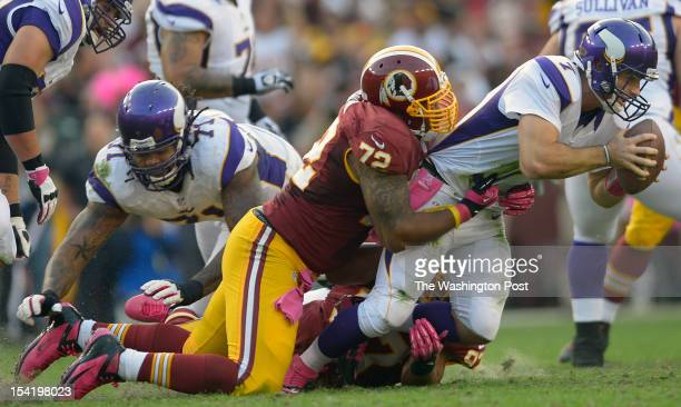 Washington's defensive end Stephen Bowen sacks Minnesota's quarterback Christian Ponder to bring up a fourth down in the second quarter as the...