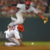 Washington's Denard Span bottom seals 2nd base and upends Cincinnati second baseman Brandon Phillips on a 6th inning throwing error on Reds catcher...