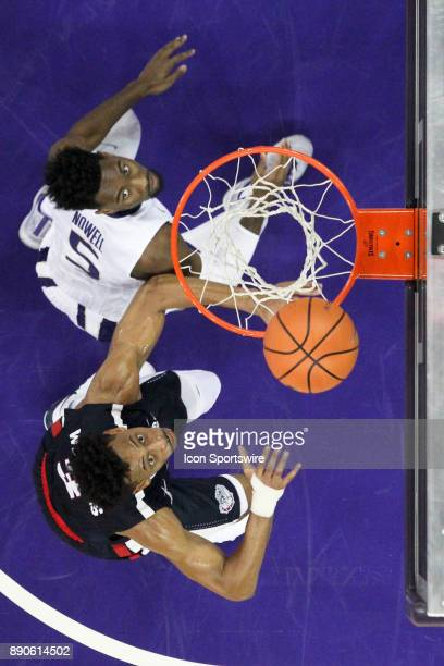 Washington's Jaylen Nowell and Gonzaga's Johnathan Williams set up under the basket for a first half rebound Gonzaga won 9770 over Washington on...