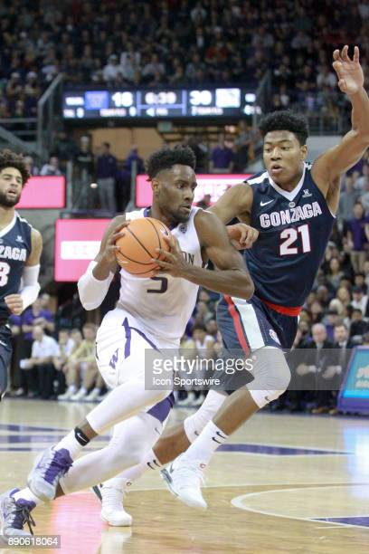 Washington's Jaylen Nowell drives to the basket while being defended by Gonzaga's Rui Hachimura Gonzaga won 9770 over Washington on December 10 2017...