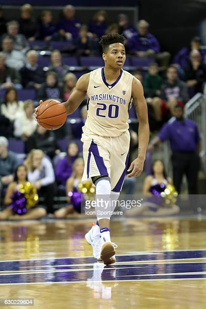 Washington's Markelle Fultz brings the ball down court during an NCAA basketball game between the Western Michigan Broncos and the Washington Huskies...