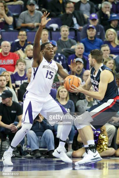 Washington's Noah Dickerson defends under the basket as Gonzaga's Killian Tillie drives to the basket Gonzaga won 9770 over Washington on December 10...