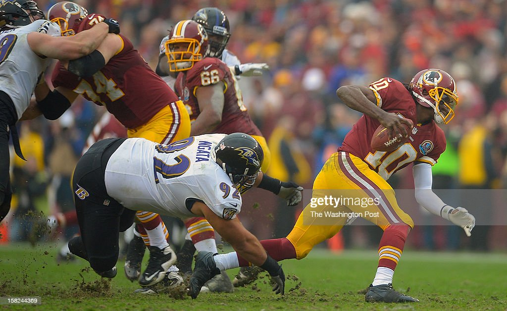 Washington's quarterback Robert Griffin III (10) scrambles out of the way of Baltimore's defensive end Haloti Ngata (92) as the Washington Redskins defeat the Baltimore Ravens 31 - 28 at FedEx Feild in Landover MD, December 9, 2012 .