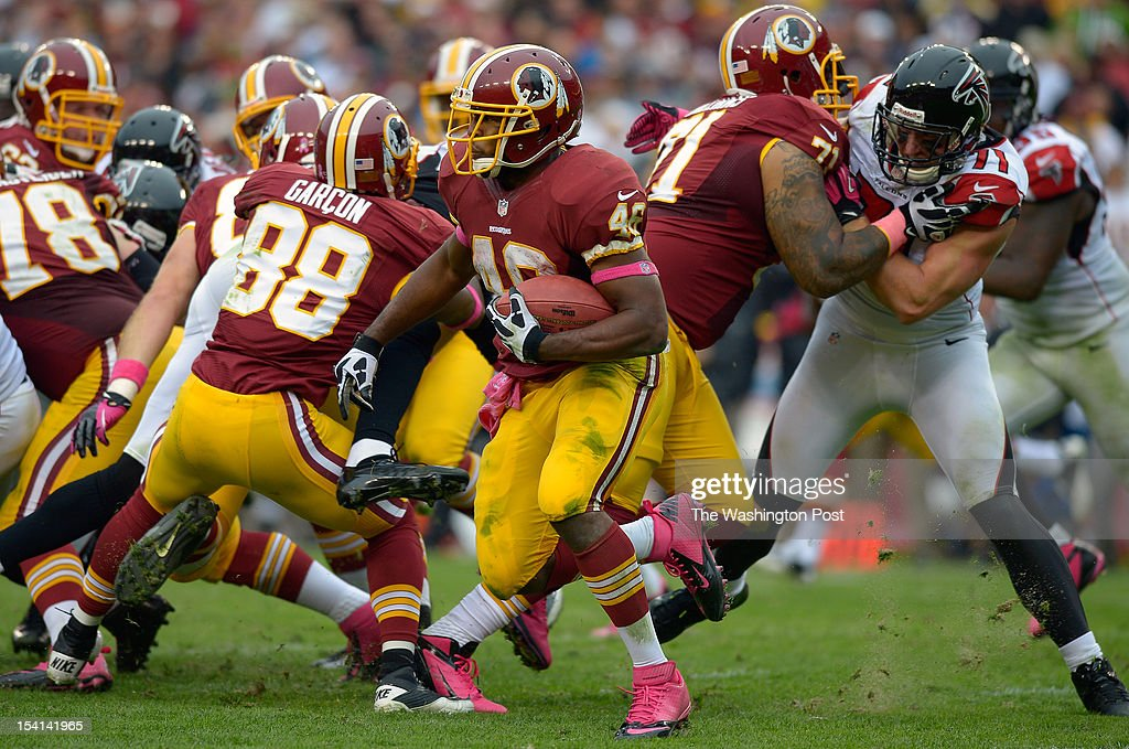 Washington's rookie running back Alfred Morris (46), center, ran for 115 yards on 18 carries during the Atlanta Falcons defeat of the Washington Redskins 24 - 17 at FedEx Field in Landover MD, October 7, 2012