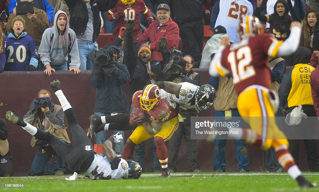 Washington's wide receiver Pierre Garcon (88), center, grabs atouchdown on a throw from Washington's back up quarterback Kirk Cousins (12), right, late in the 4th quarter to set up a tying 2 point conversion as the Washington Redskins defeat the Baltimore Ravens 31 - 28 at FedEx Feild in Landover MD, December 9, 2012 .