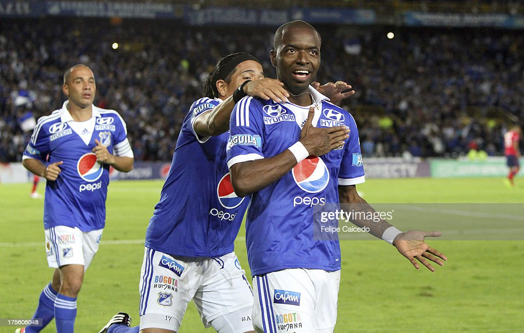<a gi-track='captionPersonalityLinkClicked' href=/galleries/search?phrase=Wason+Renteria&family=editorial&specificpeople=666364 ng-click='$event.stopPropagation()'>Wason Renteria</a> (R) of Millonarios celebrates a scored goal against Independiente Medellin during a match between Millonarios and Independiente Medellin as part of the Liga Postobon 2013 at Nemesio Camacho El Campin Stadium on August 4, 2013 in Bogota, Colombia.