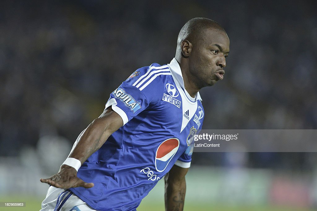 <a gi-track='captionPersonalityLinkClicked' href=/galleries/search?phrase=Wason+Renteria&family=editorial&specificpeople=666364 ng-click='$event.stopPropagation()'>Wason Renteria</a> of Millonarios celebrates the first goal against Quindio during a match between Millonarios and Deportes Quindio as part of the Liga Postobon II 2013 at Nemesio Camacho El Campin Stadium on October 2, 2013 in Bogota ,Colombia.