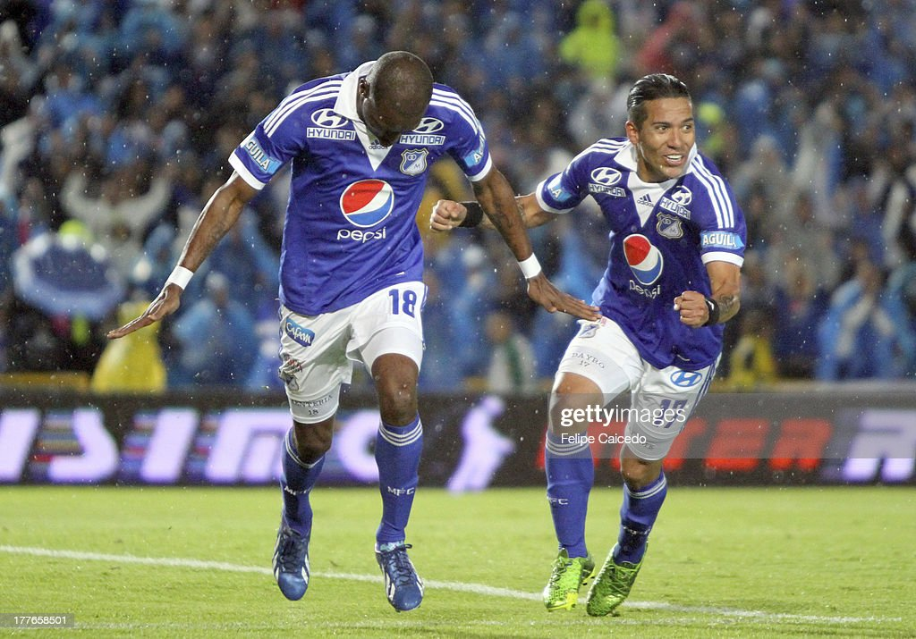 <a gi-track='captionPersonalityLinkClicked' href=/galleries/search?phrase=Wason+Renteria&family=editorial&specificpeople=666364 ng-click='$event.stopPropagation()'>Wason Renteria</a> (L) player of Millonarios celebrates his goal against Deportivo Pasto during a match as part of Liga Postobon II at Nemesio Camacho El Campin Stadium on August 25, 2013 in Bogota, Colombia.