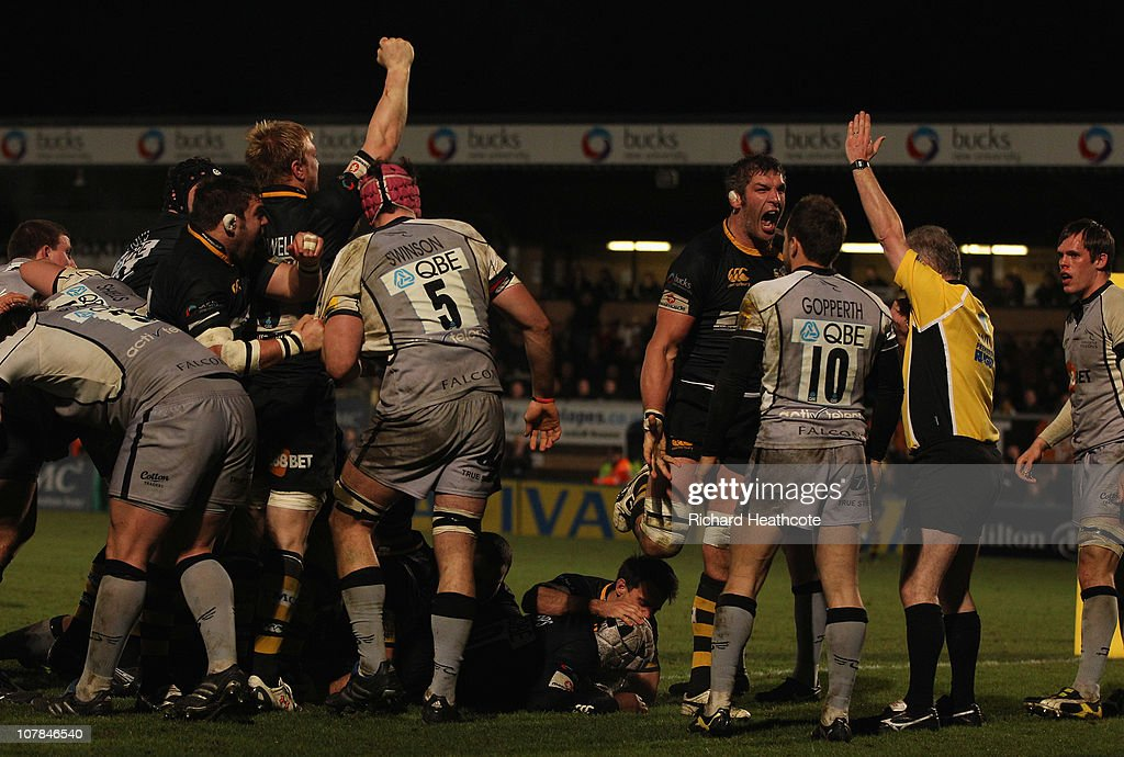 Wasps celebrate as they drive over <a gi-track='captionPersonalityLinkClicked' href=/galleries/search?phrase=Serge+Betsen&family=editorial&specificpeople=239034 ng-click='$event.stopPropagation()'>Serge Betsen</a> (on floor) to score a try during the AVIVA Premiership match between London Wasps and Newcastle Falcons at Adams Park on January 2, 2011 in High Wycombe, England.