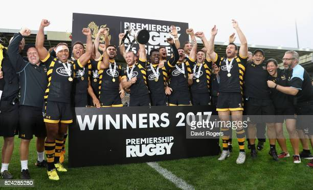 Wasps celebrate their victory over Newcastle Falcons in the Cup final during the Singha Premiership Rugby 7s Series Day Two at Franklin's Gardens on...