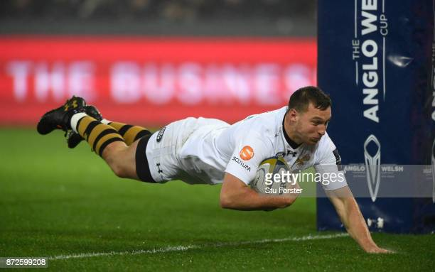 Wasps centre Brendan Macken dives over for the second Wasps try during the AngloWelsh Cup match between Ospreys and Wasps at Liberty Stadium on...