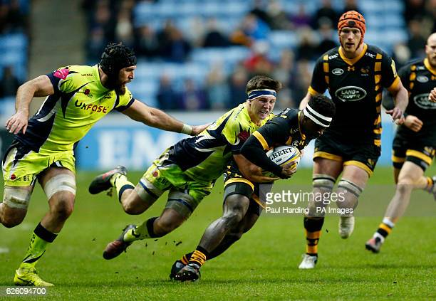 Wasps' Christian Wade and Sale Sharks' AJ MacGinty during the Aviva Premiership match at the Ricoh Arena Coventry