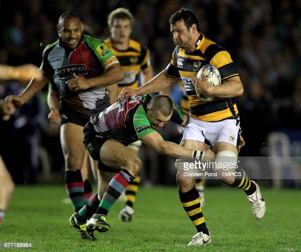 Wasps' Dan Ward Smith is tackled by Harlequins' Mike Brown