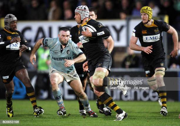 Wasps Dan WardSmith looks to avoid a tackle during the Guinness Premiership match at Twickenham Stadium London