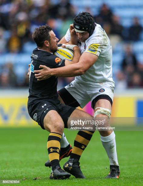 Wasps' Elliot Daly is caught by Bath Rugby's Charlie Ewels during the Aviva Premiership match between Wasps and Bath Rugby at The Ricoh Arena on...