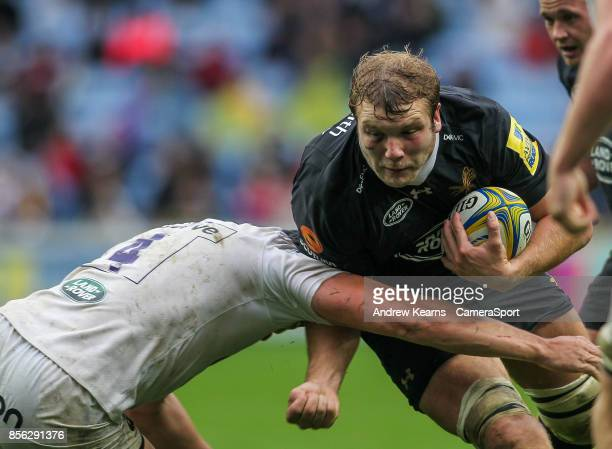 Wasps' Joe Launchbury is tackled by Bath Rugby's Charlie Ewels during the Aviva Premiership match between Wasps and Bath Rugby at The Ricoh Arena on...
