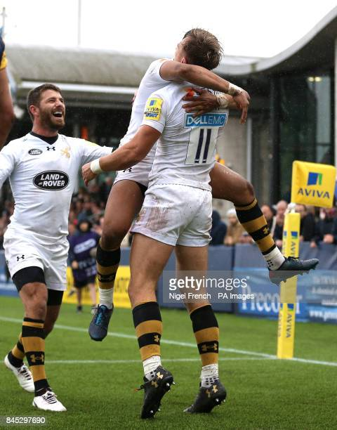 Wasps' Josh Bassett celebrates with Marcus Watson after scoring his sides third try of the game against Worcester Warriors during the Aviva...