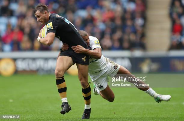 Wasps Josh Bassett is tackled by Bath's Jonathan Joseph during the Aviva Premiership match at the Ricoh Arena Coventry
