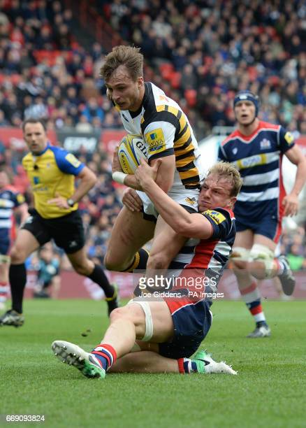Wasps' Josh Bassett is tackled by Bristol's Mitch Eadie on his way to scoring his teams first try during the Aviva Premiership match at Ashton Gate...