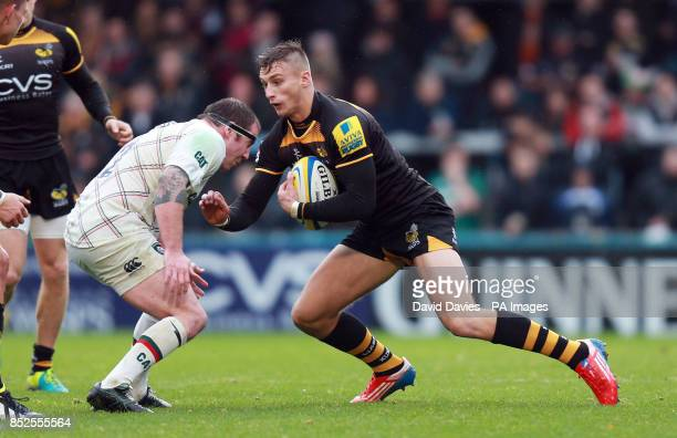 Wasps Josh Bassett runs in to Leicester's Neil Briggs during the Aviva Premiership match at Adams Park High Wycombe