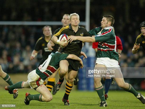Wasps' Josh Lewsey is tackled by Leicester Tigers' Sam Vesty John Holtby during Zurich Premiership game at Adams Park Wycombe