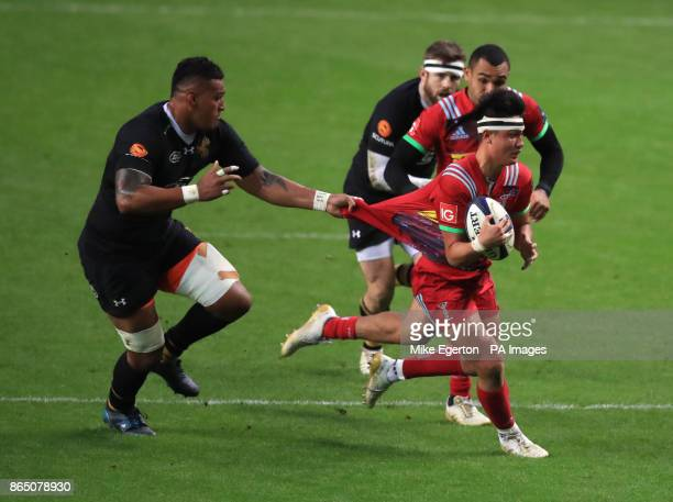 Wasps' Nathan Hughes tackles Harlequins' Marcus Smith during the Champions Cup pool one match at the Ricoh Arena Coventry