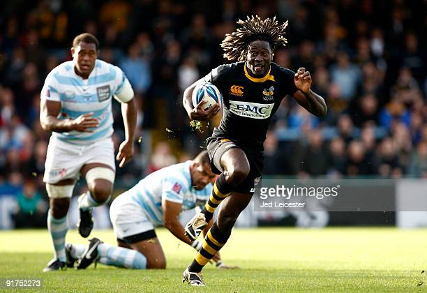 Wasps' Paul Sackey burst through the Racng Metro defence during the Amlin Challenge Cup match between London Wasps and Racing Metro 92 at the...