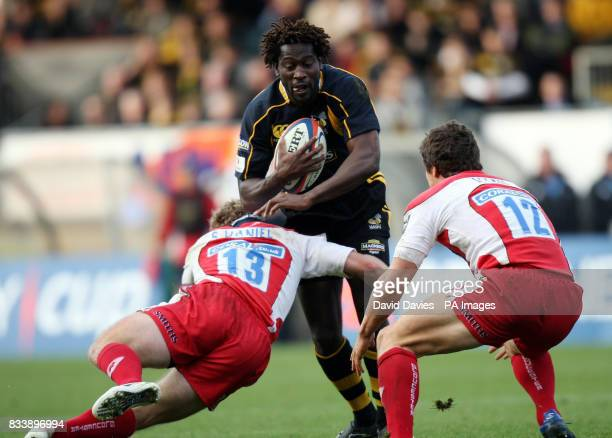 Wasps' Paul Sackey is tackled by Gloucester's James Simpson Daniel during the EDF Energy Cup match at Adams Park Wycombe