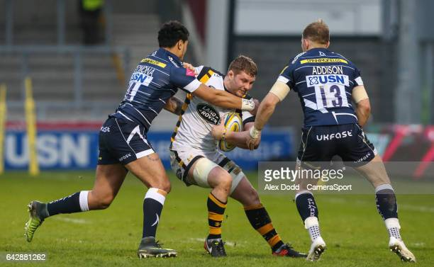 Wasps' Thomas Young is tackled by Sale Sharks' Denny Solomona during the Aviva Premiership match between Sale Sharks and Wasps at AJ Bell Stadium on...