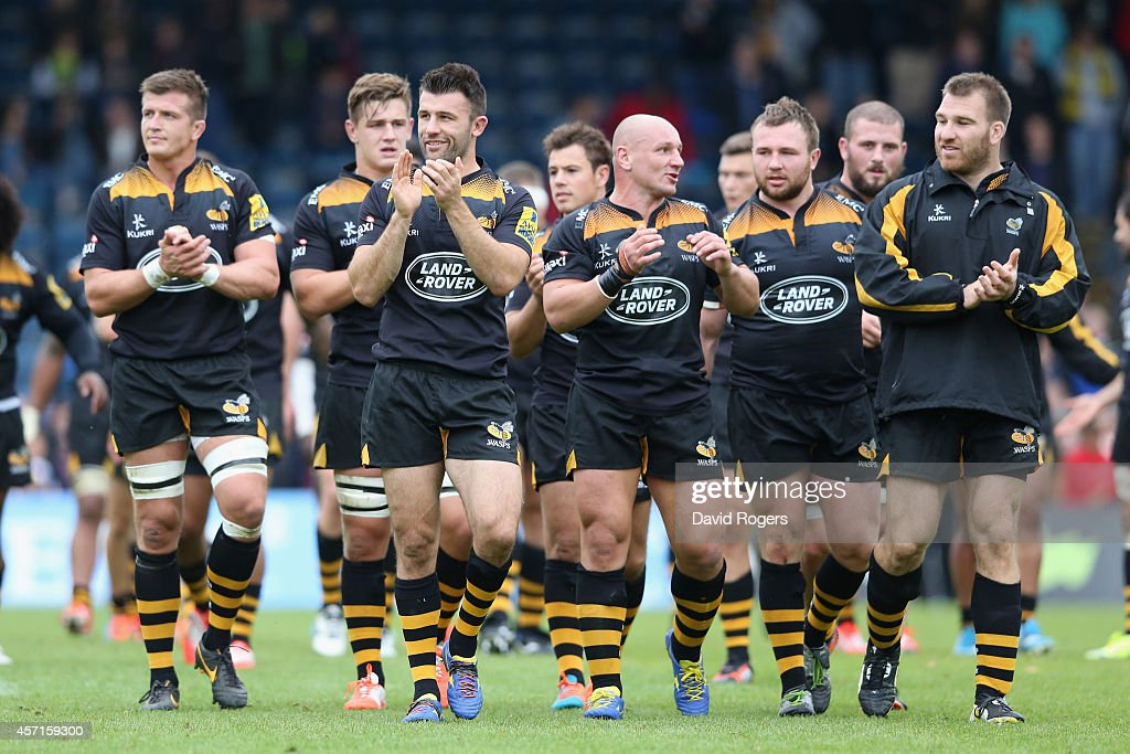 Wasps walk a lap of honour after their victory during the Aviva Premiership match between Wasps and Bath at Adams Park on October 12 2014 in High...